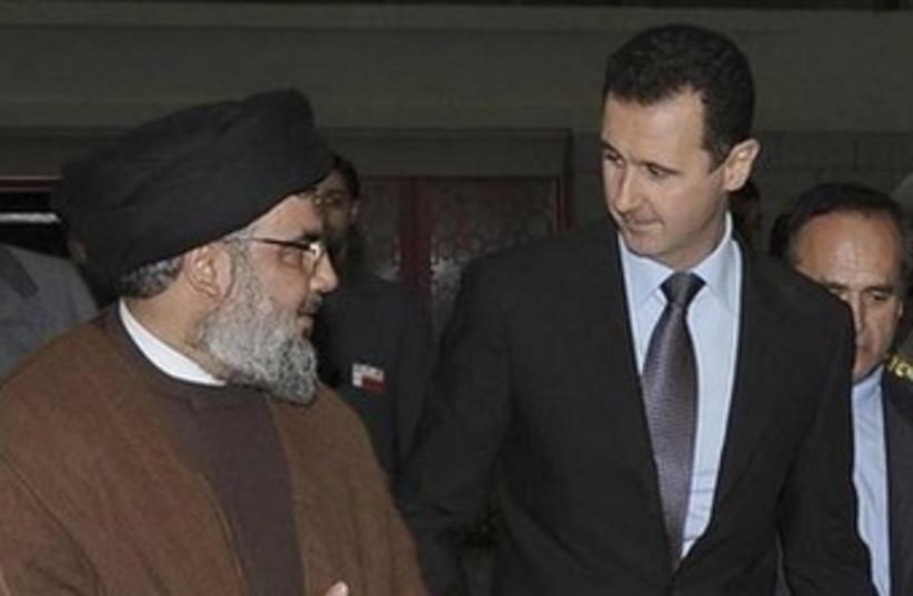 Nasrallah Assad Ahmadinejad 370 (photo credit: REUTERS/Sana)