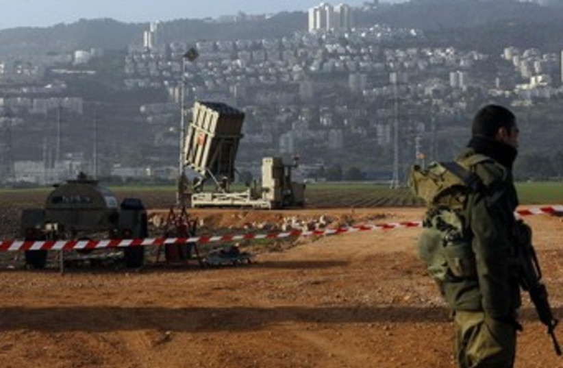 Iron Dome and soldier 370 (photo credit: Reuters)