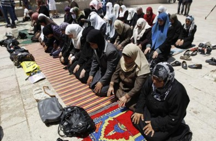 Palestinian women pray outside the Temple mount 390 (photo credit: REUTERS)