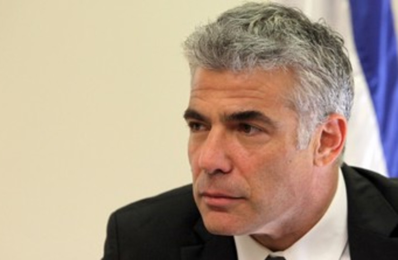 Lapid looking sullen 370 (photo credit: Marc Israel Sellem/The Jerusalem Post)