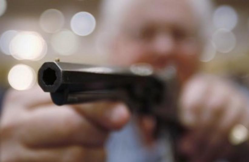 Gun [illustrative] 370 (photo credit: REUTERS/Carlo Allegri )
