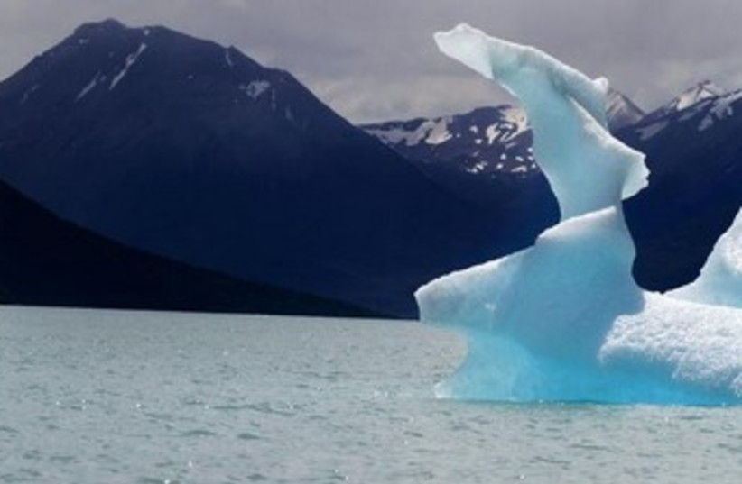 global warming ice caps melting 370 (photo credit: REUTERS)