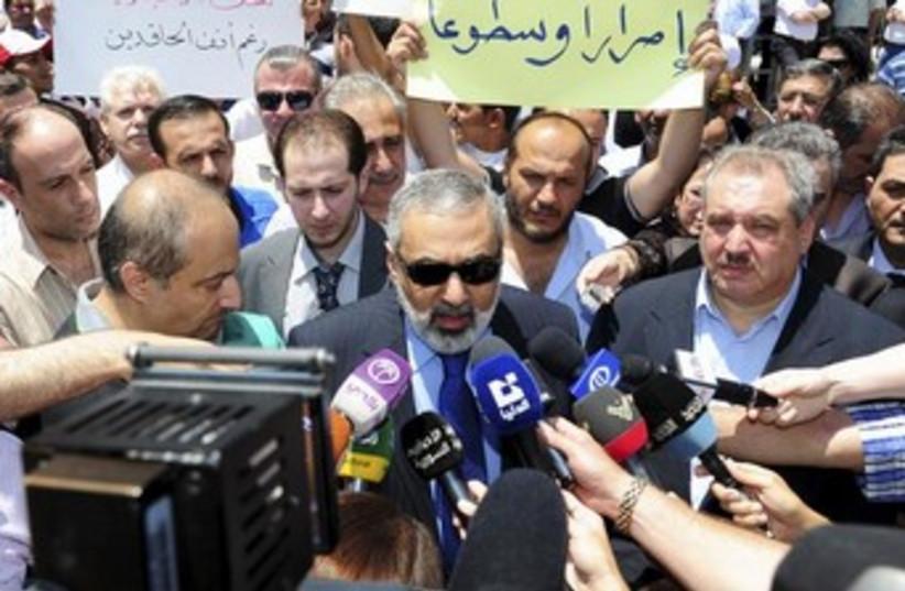 Syrian Information Minister Omran al-Zoubi (photo credit: REUTERS/SANA)