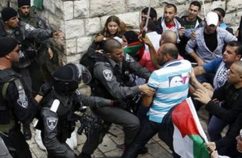Palestinians clash with police Damascus Gate (file) 370 (photo credit: REUTERS/Ammar Awad)