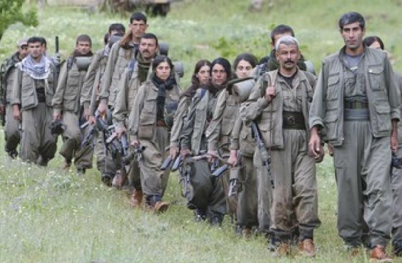 Kurdish PKK workers marching 370 (photo credit: Azad Lashkari /Reuters)