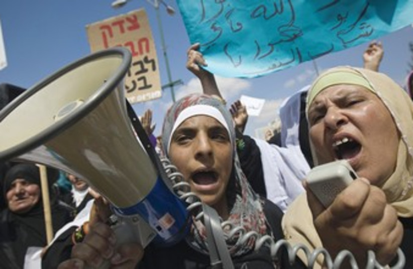 Beduin women yelling 370 (photo credit: Amir Cohen/Reuters)