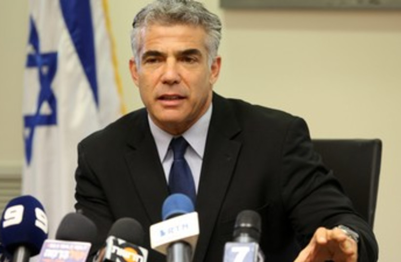 Yair Lapid at Cabinet Meeting, looking official 370 (photo credit: Marc Israel Sellem/The Jerusalem Post)