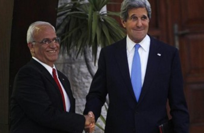 Kerry and Erekat shaking hands USE THIS ONE 370 (photo credit: REUTERS)