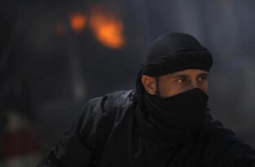 Islamist Nusra Front fighter in Syria 370 (photo credit: REUTERS)