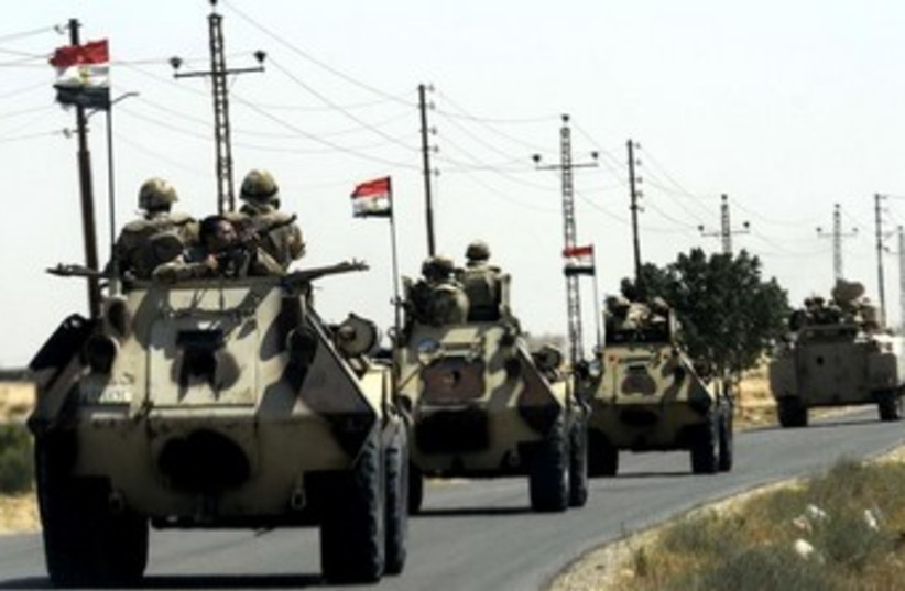 Egyptian military tanks, flags in Sinai (photo credit: REUTERS)