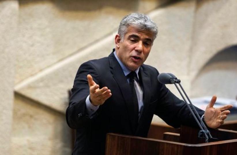 Yair Lapid Speaking521 (photo credit: Baz Ratner/Reuters)