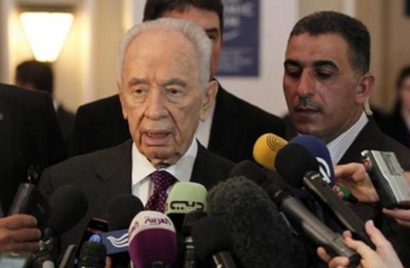 Peres at wec 26.5.13 370 (photo credit: Reuters)
