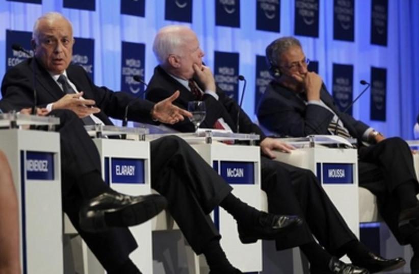 Nabil Elaraby, John McCain and Amr Moussa at the WEC, May 25, 2013.