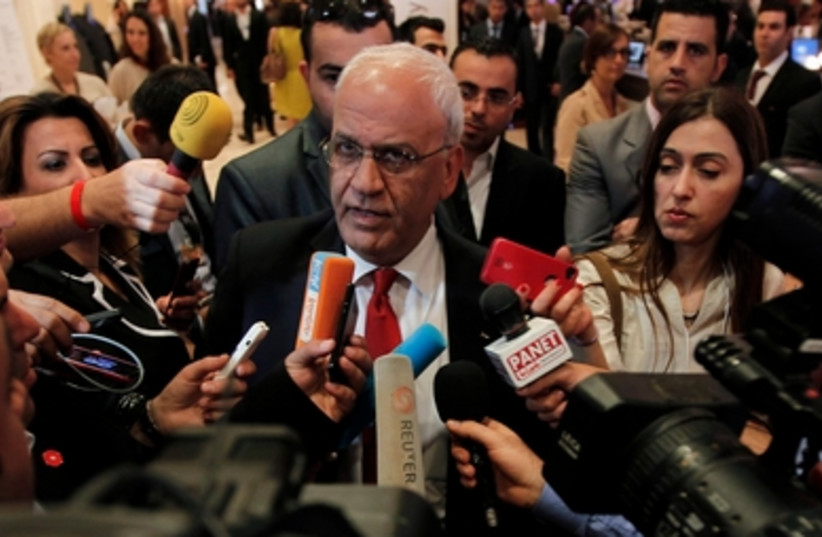 Chief Palestinian negotiator Saeb Erekat  speak to reporters at the WEC in Jordan, May 26, 2013.