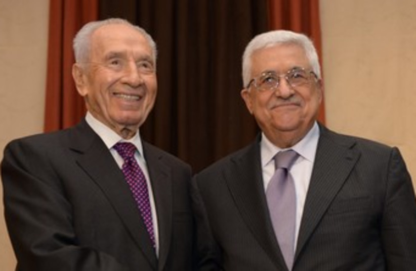 Shimon Peres and Abbas at WEF 370 (photo credit: Mark Neiman/GPO)