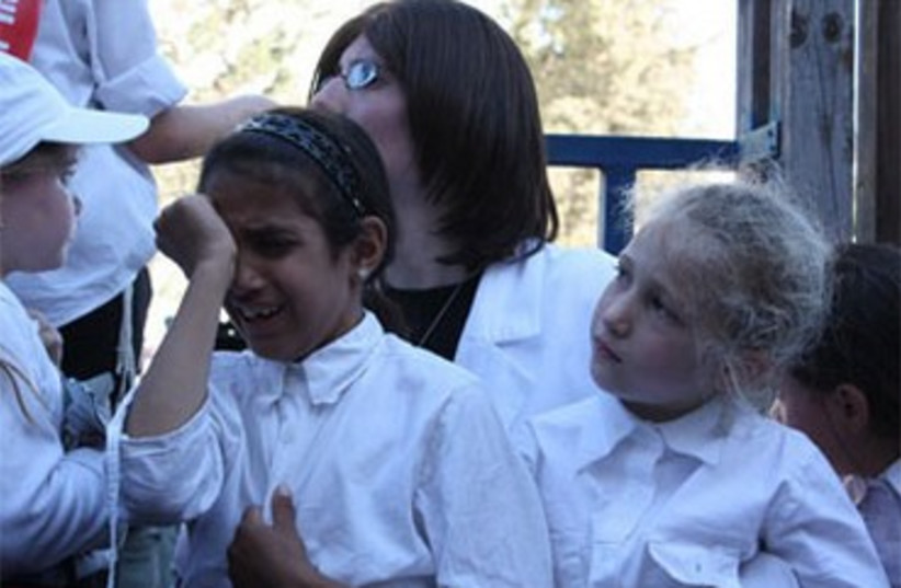 Sephardi school girl crying 370 (photo credit: Courtesy Noar KaHalacha)