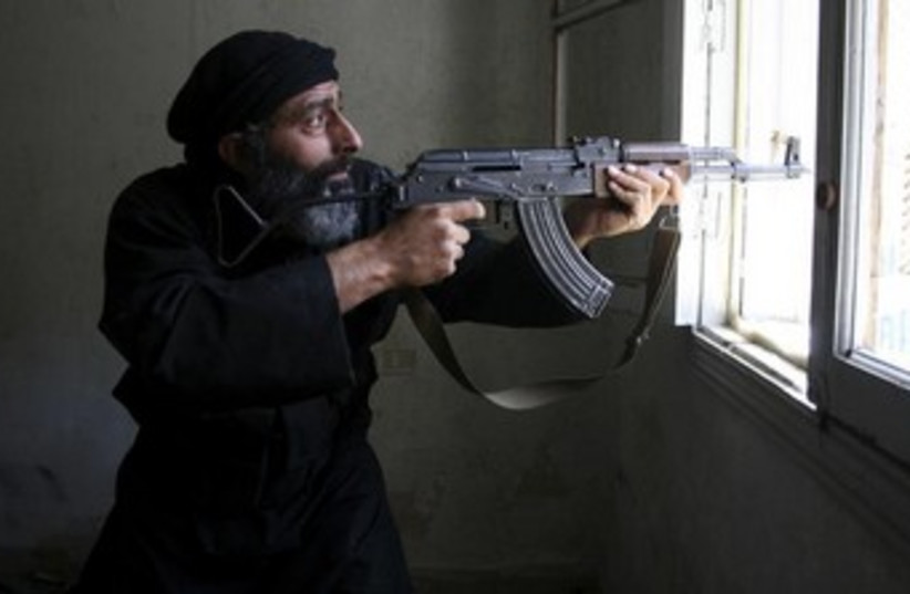 Free Syrian Army fighter 370 (photo credit: REUTERS/Aref Hretani)
