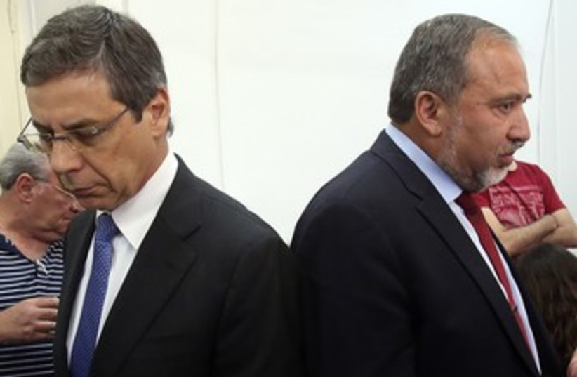 Liberman, Ayalon looking away from each other 370 (photo credit: Marc Israel Sellem/The Jerusalem Post)