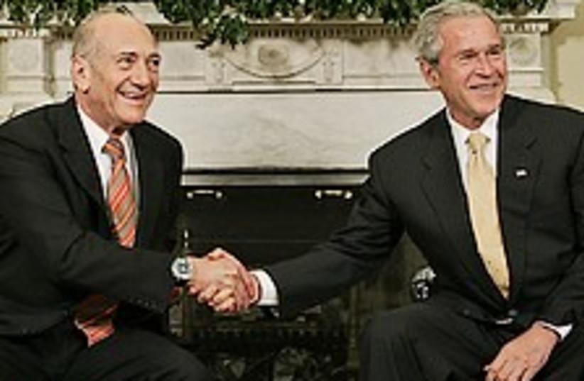 bush and olmert 224.88 (photo credit: )