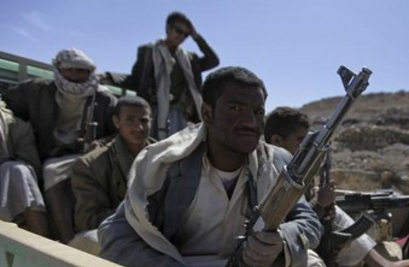 Yemen's al-Houthi Shi'ite fighters 370 (photo credit: REUTERS/Mohamed al-Sayaghi)