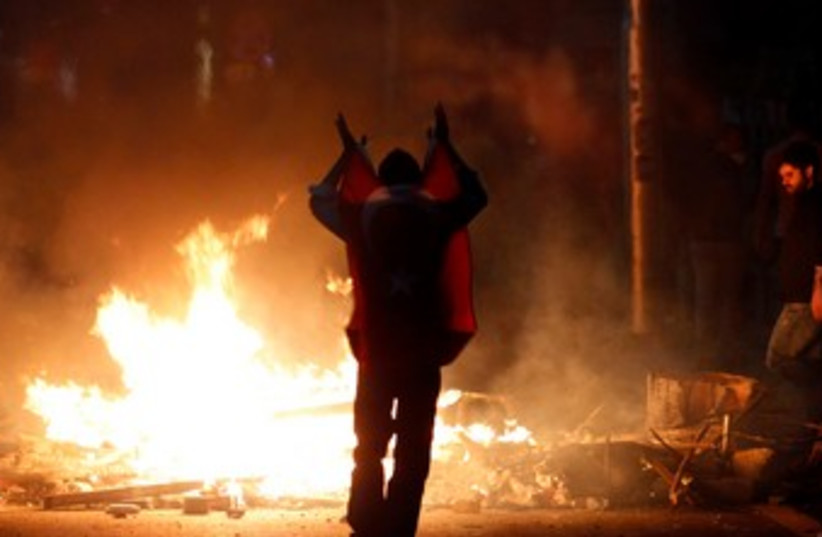 Turkish protester in Ankara 370 (photo credit: REUTERS)