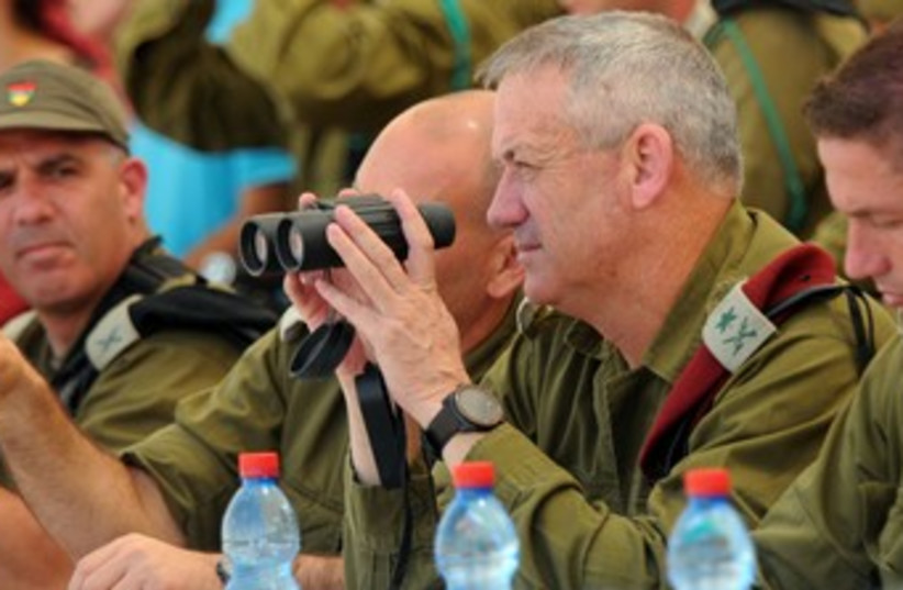 Benny Gantz with binoculars 370 (photo credit: IDF Spokesperson)