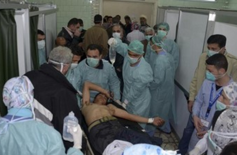 injured man in apparent chemical attack 370 (photo credit: REUTERS/George Ourfalian)