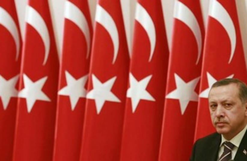 Tayyip Erdogan with flags 370 (photo credit: REUTERS/Umit Bektas )