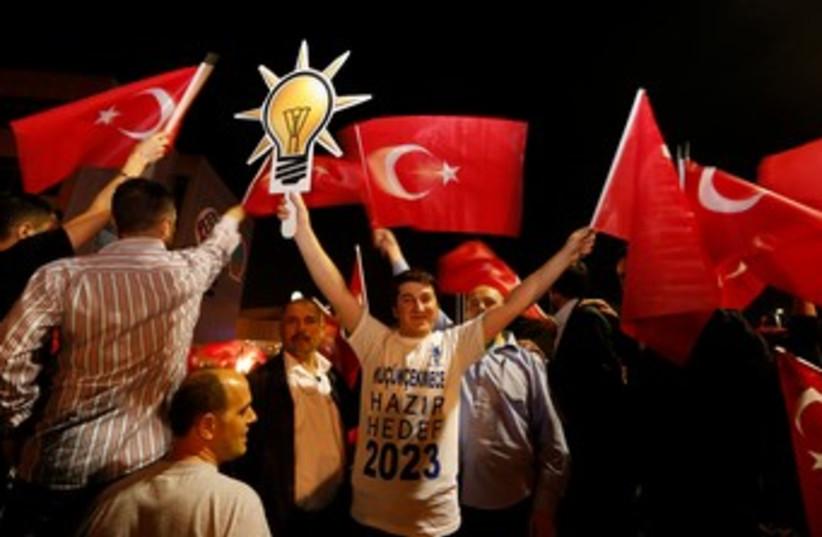 Supporters of  Erdogan wave flag 370 (photo credit: REUTERS)