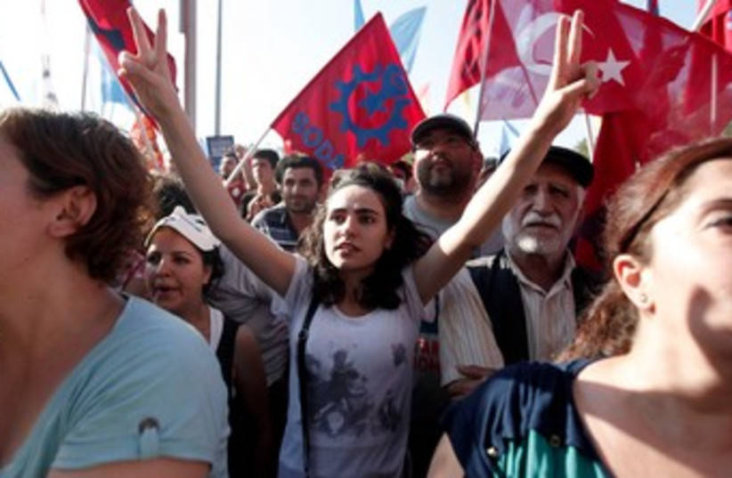 protesters at taksim square in turkey 370 (photo credit: REUTERS)