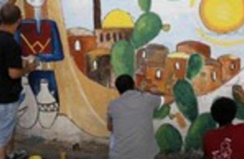 Palestinian refugees paint mural of Jlem in refugee cam, 150 (photo credit: REUTERS/Ammar Awad)