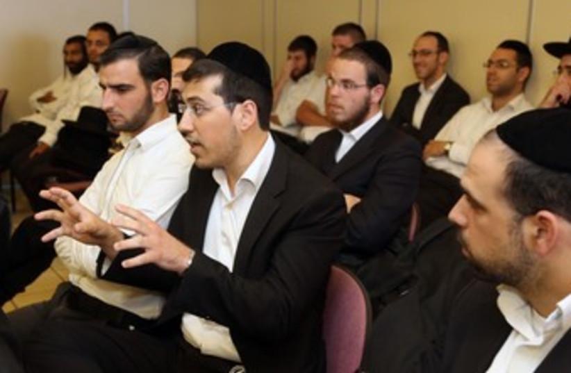 haredi men sitting 370 (photo credit: Marc Israel Sellem/The Jerusalem Post)