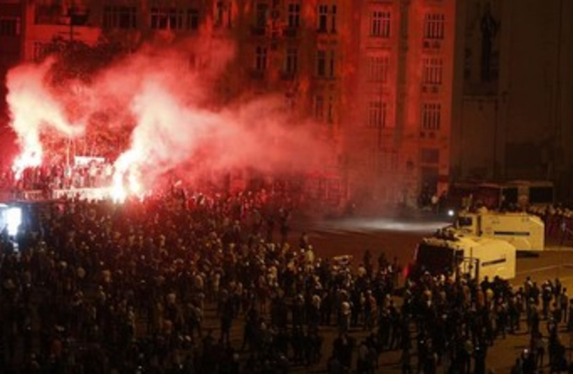 turkey protests night flares 370 (photo credit: REUTERS)