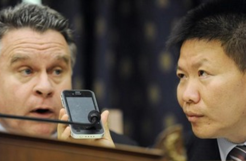 speaking on phone with blind man 370 (photo credit: Reuters)