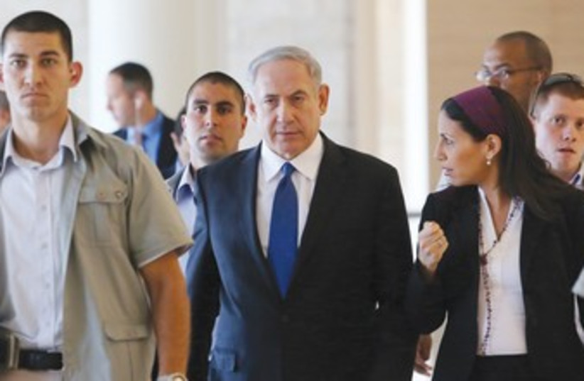 Netanyahu leaving Knesset 370 (photo credit: Marc Israel Sellem/The Jerusalem Post)