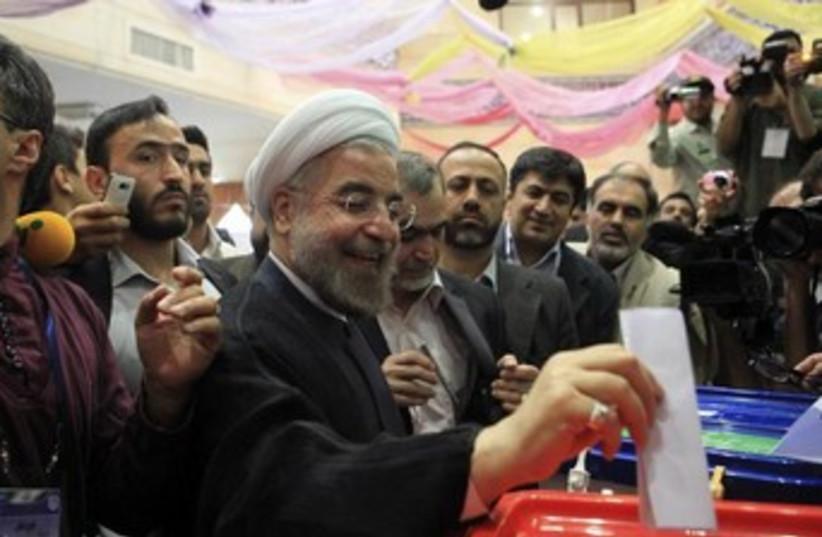 Hassan Rohani votes 370 (photo credit: REUTERS/Yalda Moayer)