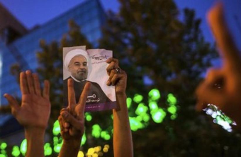 Supporters of Rohani 370 (photo credit: REUTERS/Fars News/Sina Shiri )