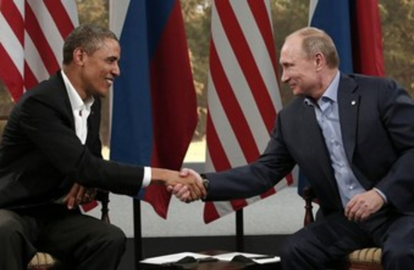 Obama and Putin at G8 summit 370 (photo credit: REUTERS/Kevin Lamarque )