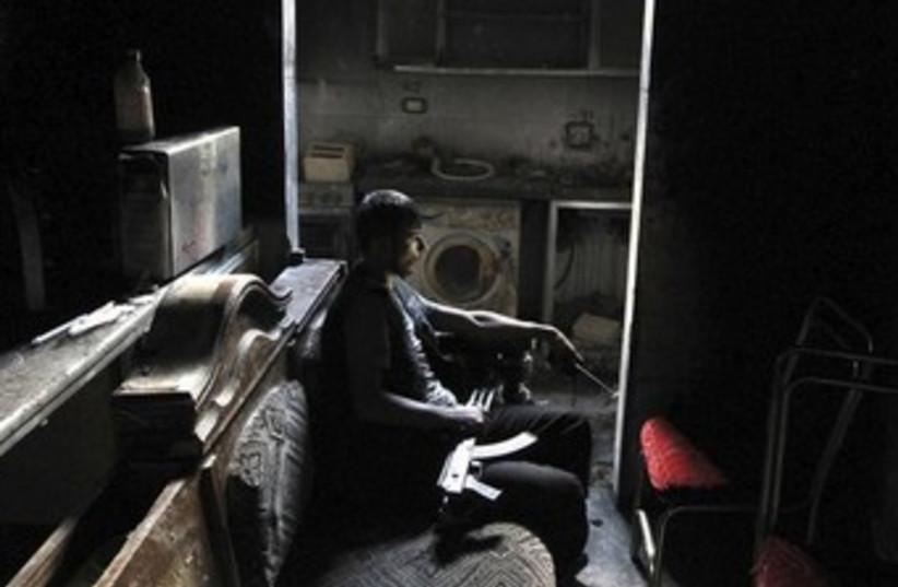 Free Syrian Army gunman in Aleppo_370 (photo credit: REUTERS/Muzaffar Salman)