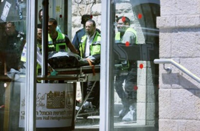 bodybag of J'lem Kotel shooting 370 (photo credit: Marc Israel Sellem/The Jerusalem Post)