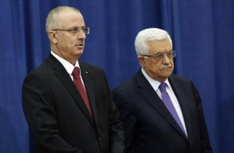 Abbas and Hamdallah 370 (photo credit: REUTERS/Mohamad Torokman)