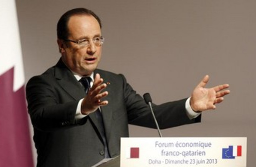 Hollande gesturing wildly, 370 (photo credit: REUTERS/Mohammed Dabbous)
