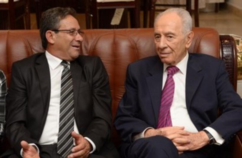 President Shimon Peres meets Abu Ghosh Mayor Abu Jaber 370 (photo credit: Mark Neiman/GPO)