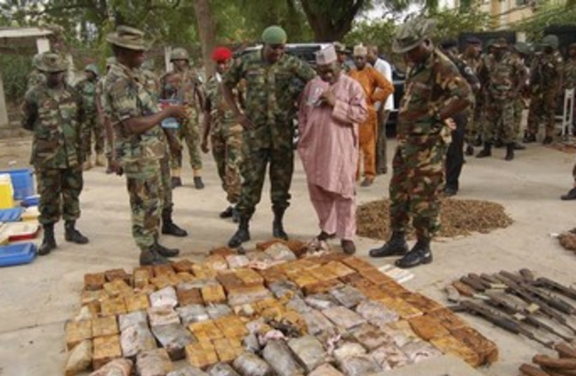 nigeria security with hezbollah seized ammunition 370 (photo credit: REUTERS)