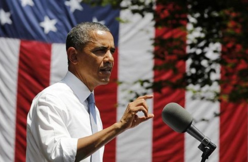 Obama gestures as he speaks into microphone 521 (photo credit: REUTERS)