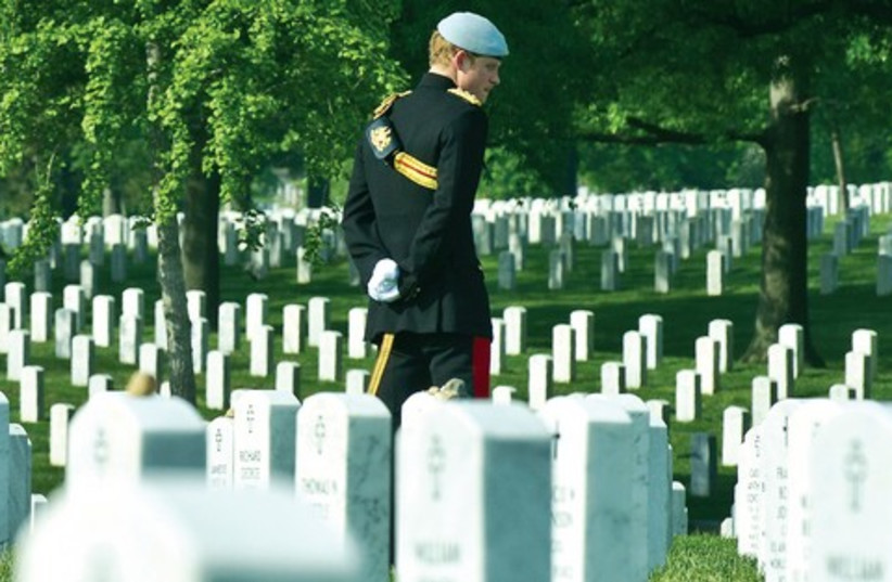 Prince Harry of Britain visits Arlington National Cemetery (photo credit: Reuters)