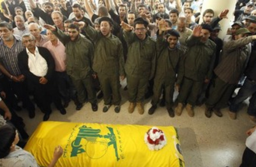 Hezbollah supporters at funeral of slain member 370 (photo credit: REUTERS)