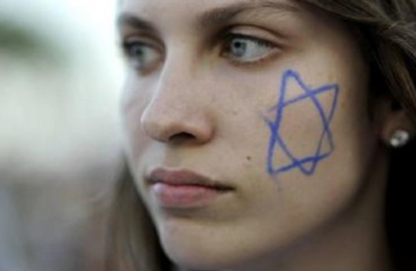 israeli girl with star of david painted on face 370 (photo credit: REUTERS)