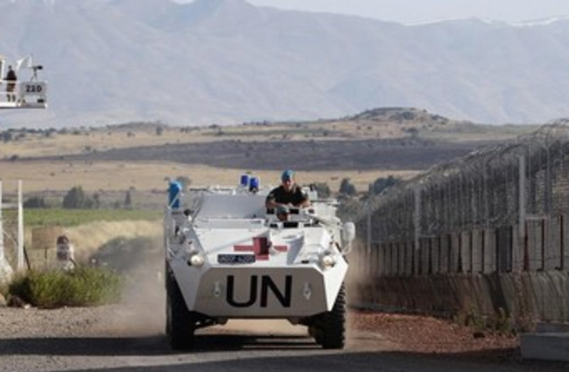 UN peacekeeping tank on golan heights 370 (photo credit: REUTERS)