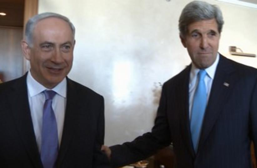 Kerry pulls Netanyahu by the arm 370 (photo credit: Matty Stern/US Embassy Tel Aviv)